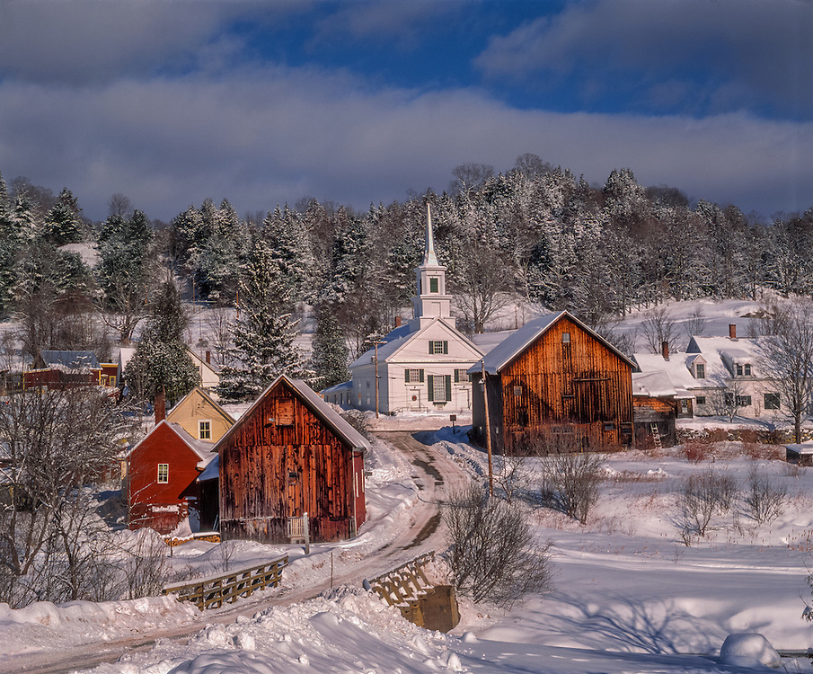 New England village in winter, with homes, church & snow covered trees, Waits River, VT