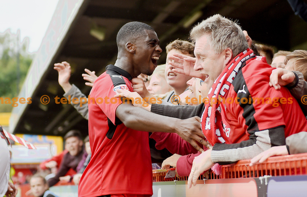 Enzio Boldewijn of Crawley is mobbed by fans and players after scoring the late second goal during the Sky Bet League 2 match between Crawley Town and Luton Town at the Checkatrade Stadium in Crawley. September 17, 2016.<br /> Simon  Dack / Telephoto Images<br /> +44 7967 642437