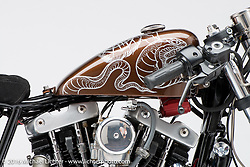 """""""Iron Mono"""", a cafe racer built from an ironhead sportster by Kevin Dunworth of Loaded Gun Customs in Selbyille, DE and owned by Rob Clark. Photographed by Michael Lichter in Sturgis SD August 4, 2016 ©2016 Michael Lichter"""