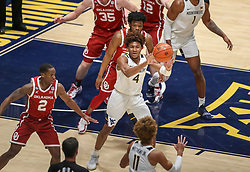 Feb 13, 2021; Morgantown, West Virginia, USA; West Virginia Mountaineers guard Miles McBride (4) passes out to forward Emmitt Matthews Jr. (11) during the first half against the Oklahoma Sooners at WVU Coliseum. Mandatory Credit: Ben Queen-USA TODAY Sports