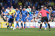 AFC Wimbledon midfielder Scott Wagstaff (7) getting fouled during the EFL Sky Bet League 1 match between AFC Wimbledon and Bristol Rovers at the Cherry Red Records Stadium, Kingston, England on 19 April 2019.