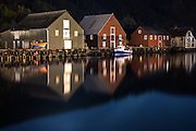 Nightshot of boathouses in Fosnavåg harbour, Norway | Nattbilde av nausta i fosnavåg havn, Norge.