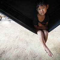 A boy sits in a hammock in Takéo province, Cambodia