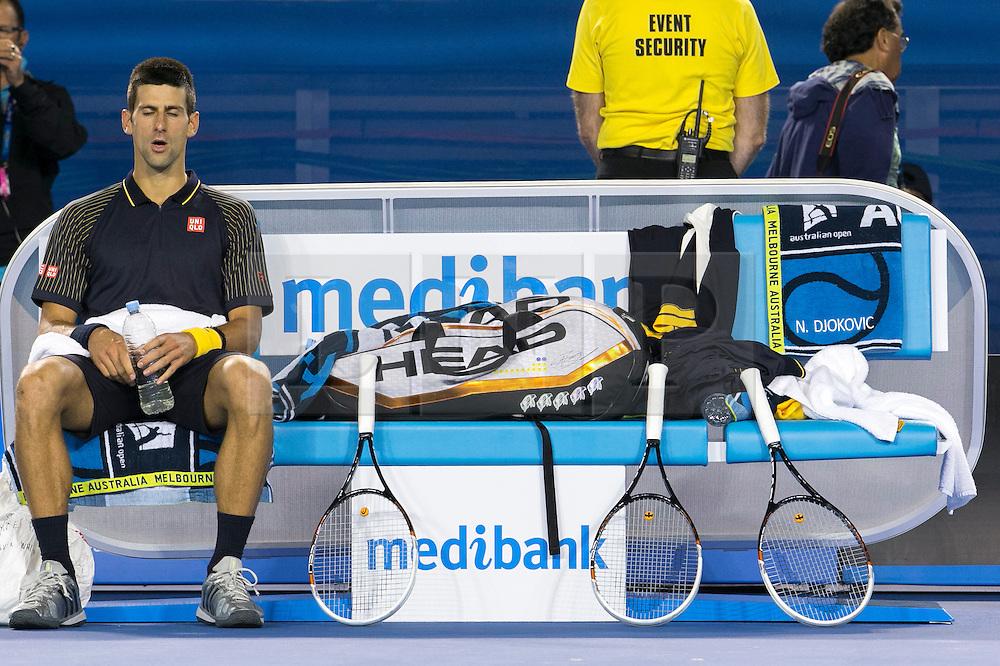 © Licensed to London News Pictures. 27/01/2013. Melbourne Park, Australia. Novak Djokovic resting during the Mens Final between Novak Djokovic and Andy Murray of the Australian Open. Photo credit : Asanka Brendon Ratnayake/LNP
