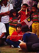 Children celebrating Malaysia National Day, Kuala Lumpur, Malaysia.