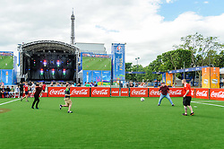 Fans from Wales and England play football beneath the Eiffel Tower in Paris, ahead of their countries meeting in Group B on Thursday. Images from the UEFA EURO 2016, 14 June 2016 in Fan Zone. (c) Paul Roberts   Edinburgh Elite media. All Rights Reserved