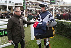 Clerk of the Course Simon Claisse chats with jockey Davy Russell during day two of The International meeting at Cheltenham Racecourse