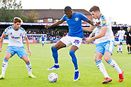 Macclesfield Town midfielder Emmanuel Osadebe challenged by Crawley Town defender Jordan Tunnicliffe during the EFL Sky Bet League 2 match between Macclesfield Town and Crawley Town at Moss Rose, Macclesfield, United Kingdom on 7 September 2019.