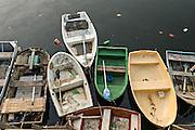 Small rowboats along the boat basin in Guanabara Bay at the Urca neighborhood in Rio de Janeiro, Brazil.