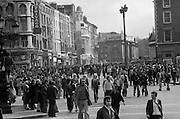 Sinn Fein (Provo) Dublin Parade.   K22..1976..25.04.1976..04.25.1976..25th April 1976..Sinn Fein held an Easter Rising Commemorative  parade..The parade started at St Stephens Green, Dublin and proceeded through the streets to the G.P.O.in O'Connell Street, the scene of the centre of the 1916 uprising..A view down WestMoreland Street as the parade approaches O'Connell Street.