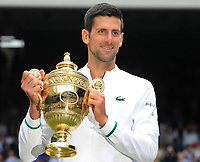 Lawn Tennis - 2021 All England Championships - Men's Final Sunday - Wimbledon - Novak Djokovic  v Matteo Berrettini on Centre Court<br /> <br /> Novak Djokovic with the Mens singles trophy<br /> <br /> Credit : COLORSPORT / Andrew Cowie