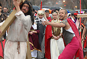 Actors Juan Ponce, 27 (L) and Jesus Ibarro, 21 (R), portray Jesus Christ and his persecutors during a Good Friday Via Crucis at St. Jerome Catholic Church in Chicago's Rogers Park neighborhood. The religious portrayal recounts the biblical steps of Jesus Christ being condemned to death, followed by his crucifixion and entombment.