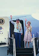 President Ronald Reagan and First Lady Nancy Reagan wave as they depart Guam on April 29, 1986<br /> Photo by Dennis Brack