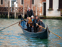 passengers being ferried across Grand Canal in Venice by Traghetto public ferry gondola