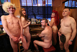 NOTE NUDITY (left to right) Jacob Bloomfield, Maria Beadell, pianist Luke Meredith, Emma Ruth and Davidos Pass, taking part in London's first nudist pub singalong at the Coach And Horses in Soho.