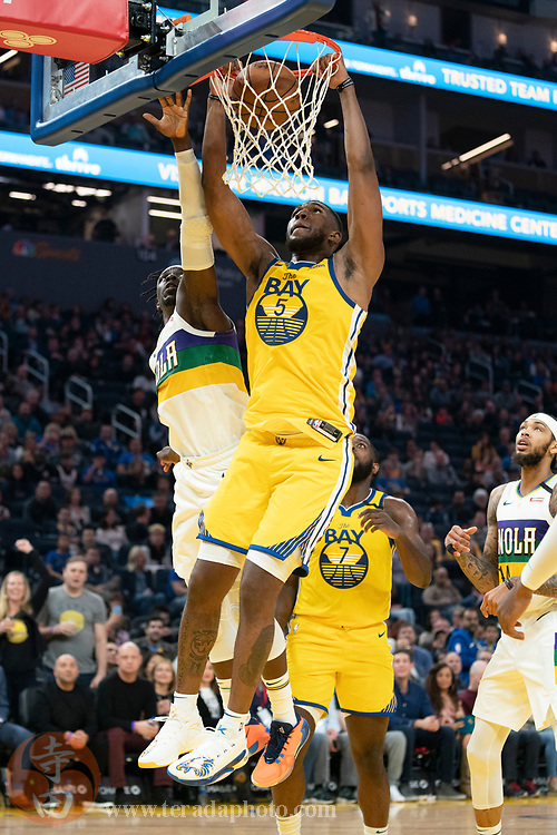 February 23, 2020; San Francisco, California, USA; Golden State Warriors forward Kevon Looney (5) dunks the basketball during the second quarter against the New Orleans Pelicans at Chase Center.
