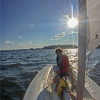 Gordon Wiltsie sails a laser on Lake of the Woods, Ontario, Canada.