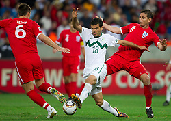 Aleksander Radosavljevic of Slovenia between John Terry of England and Frank Lampard of England during the 2010 FIFA World Cup South Africa Group C Third Round match between Slovenia and England on June 23, 2010 at Nelson Mandela Bay Stadium, Port Elizabeth, South Africa. England defeated Slovenia 1-0 and qualified for the next round, Slovenia not. (Photo by Vid Ponikvar / Sportida)