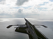 Nederland, Friesland, Gemeente Wonseradeel, 16-04-2012; Afsluitdijk ter hoogte van Breezanddijk, het voormalig werkeiland Breezand. Gezien naar de kust van Noord-Holland, aan de horizon op 32 km. Waddenzee rechts, IJsselmeer links..Enclosure Dam at the height of Breezanddijk, former 'work island' Breezand, seen in the direction of the Noord-Holland coast at the horizon (32 kilometers away). IJsselmeer lake (right), the Wadden Sea (left)..luchtfoto (toeslag), aerial photo (additional fee required).foto/photo Siebe Swa