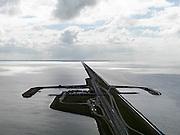 Nederland, Friesland, Gemeente Wonseradeel, 16-04-2012; Afsluitdijk ter hoogte van Breezanddijk, het voormalig werkeiland Breezand. Gezien naar de kust van Noord-Holland, aan de horizon op 32 km. Waddenzee rechts, IJsselmeer links..Enclosure Dam at the height of Breezanddijk, former 'work island' Breezand, seen in the direction of the Noord-Holland coast at the horizon (32 kilometers away). IJsselmeer lake (right), the Wadden Sea (left)..luchtfoto (toeslag), aerial photo (additional fee required).foto/photo Siebe Swa