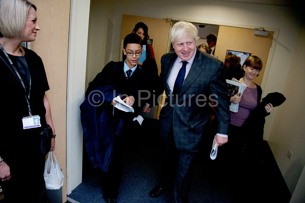 London, UK. Friday 19th October 2012. The Mayor of London, Boris Johnson talks to a student at Pimlico Academy secondary school as he unveils ambitious plans to make London a world leader in education. The announcement coincides with the publication of the final report from the Mayor's Education Inquiry, which the Mayor commissioned to look at the challenges facing London's schools.