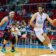 Anadolu Efes's Stratos Perperoglou (R) and Trabzonspor's Sean James Marshall (L) during their Turkish Basketball League Play Off Semi Final round 2 match Anadolu Efes between Trabzonspor at Abdi Ipekci Arena in Istanbul Turkey on Friday 31 May 2015. Photo by Aykut AKICI/TURKPIX