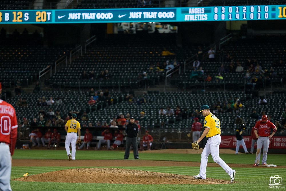 Oakland Athletics relief pitcher Blake Treinen (39) struggles on the mound against the Los Angeles Angels at Oakland Coliseum in Oakland, California, on September 5, 2017. (Stan Olszewski/Special to S.F. Examiner)