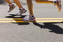 detail of runners legs on street