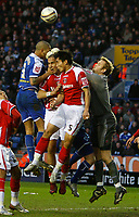 Photo: Steve Bond/Sportsbeat Images.<br /> Leicester City v Charlton Athletic. Coca Cola Championship. 29/12/2007. Keeper Nicky Weaver punches clear under pressure