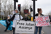 Supporters of WikiLeaks founder Julian Assange demonstrate in the road outside Woolwich Crown Court during his extradition hearing on 25th February 2020 in London, United Kingdom. Wikileaks founder Julian Assange is wanted in the United States to face charges of attempted hacking and breaches of the espionage act, related to the publication of classified US military documents. He faces a maximum of 175 years in prison.