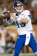 AUSTIN, TX - NOVEMBER 7:  Ryan Willis #13 of the Kansas Jayhawks drops back to pass against the Texas Longhorns during the 1st quarter on November 7, 2015 at Darrell K Royal-Texas Memorial Stadium in Austin, Texas.  (Photo by Cooper Neill/Getty Images) *** Local Caption *** Ryan Willis