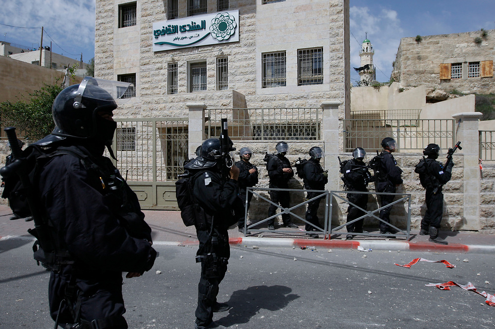 Israeli police officers seen during clashes with Palestinians in the east Jerusalem neighborhood of Sur Baher following<br /> an event where a Palestinian man was killed by Israeli police after he tried to drive into a checkpoint near Sur Baher, on April 7, 2009. The incident took place shortly after police demolished the house of Hussam Dwayyat, who went on a rampage in Jerusalem's busy Jaffa Street in June. Smashing vehicles and overturning a bus with his machinery, he killed three people and injured 45 others, before he was shot dead.