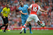 Manchester City's Frank Lampard collades with Arsenal's Aaron Ramsey. Barclays Premier league match, Arsenal v Manchester city at the Emirates Stadium in London on Saturday 13th Sept 2014.<br /> pic by John Patrick Fletcher, Andrew Orchard sports photography.