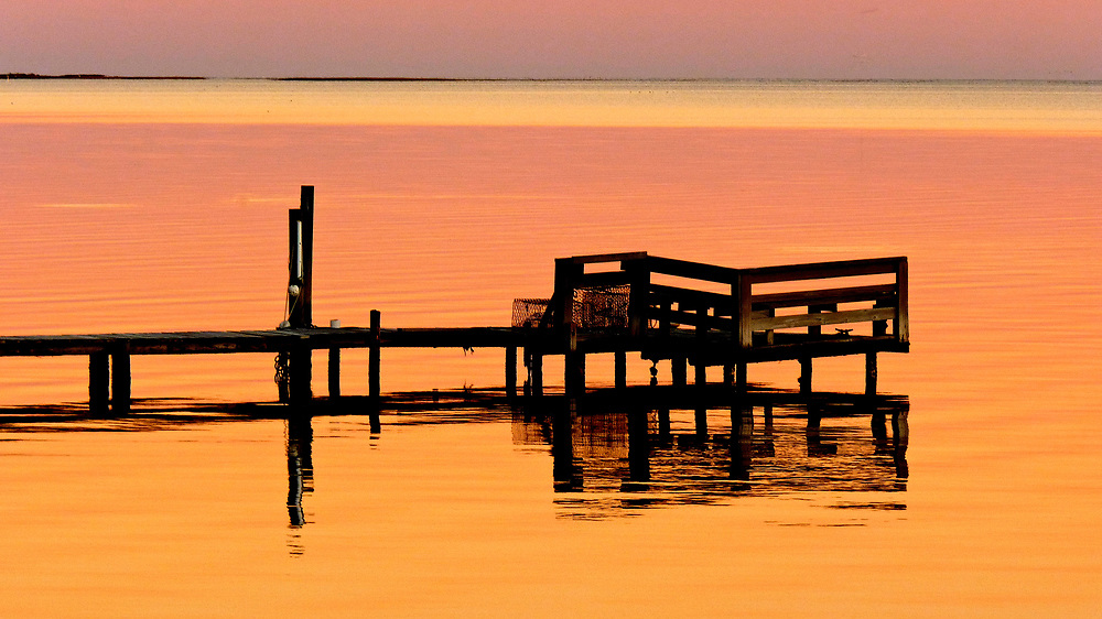 This image is one of many captured in what was likely the most amazing thirty minutes of my photographic experience.  Shot on one of our annual visits to Carrabelle on Florida's Forgotten Coast, I felt both stunned and grateful to experience such a beautiful scene.