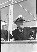With her cargo of 600 tonnes of foodstuff, drugs and blankets for famine ridden Biafra, the Irish mercy ship Columcille sails out of Dublin, with Captain P. O'Saeghdha in command and a crew of 12, among which is a seaman priest, Rev. Fr. Joseph Fitzgibbon, the Limerick born Holy Ghost Father, who has volunteered as third engineer on the vessel..Captain Paudraig O'Seaghdha as the ship sails from Dublin Port..06.09.1968