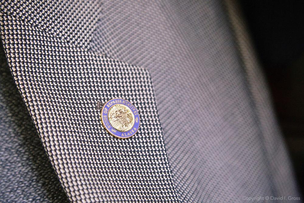 A lapel pin for the Alaska House of Representatives on Rep. Democratic Rep. Chris Tuck's lapel.