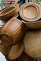 Cane baskets and goods for sale are filed up on bicycles and peddled around the streets of the  old quarter in Hanoi.