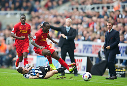 19.10.2013, St. James Park, New Castle, ENG, Premier League, ENG, Premier League, Newcastle United vs FC Liverpool, 8. Runde, im Bild Liverpool's Victor Moses is tackled by Newcastle United's Mathieu Debuchy // during the English Premier League 8th round match between Newcastle United and Liverpool FC St. James Park in New Castle, Great Britain on 2013/10/19. EXPA Pictures © 2013, PhotoCredit: EXPA/ Propagandaphoto/ David Rawcliffe<br /> <br /> *****ATTENTION - OUT of ENG, GBR*****