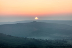 © Licensed to London News Pictures. 09/04/2017 . CASTLETON , UK. Sunrise at Mam Tor , near Castleton in the Peak District, Derbyshire. Today is forecast to be the hottest day of the year so far.<br />