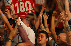 Fans celebrate a 189 scored during the darts  match between England' s Dave Chisnall and  England's multi darts World Champion Phil Taylor  in the Darts World Championships at Alexandra Palace, London, Tuesday, Dec.. 27, 2011. photo by morn/I-Image