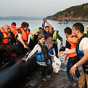 Thursday 10 September 2015 at 18:52 Aysha arrives to Europe. The boat that brought her was carrying around 50 Syrians, men women and children and arrived at the beach of Kagia, near Skala Sikaminias at the northern shores of Lesbos island.