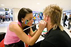 Face painting at Nelson Mandela Square shopping centre in Sandton on June 12, 2010 in Johannesburg, South Africa.  (Photo by Vid Ponikvar / Sportida)