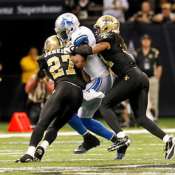 December 4, 2011; New Orleans, LA, USA; New Orleans Saints safety Malcolm Jenkins (27) and cornerback Patrick Robinson (21) force an incomplete pass to Detroit Lions wide receiver Calvin Johnson (81) during a game at the Mercedes-Benz Superdome. The Saints defeated the Lions 31-17. Mandatory Credit: Derick E. Hingle-US PRESSWIRE