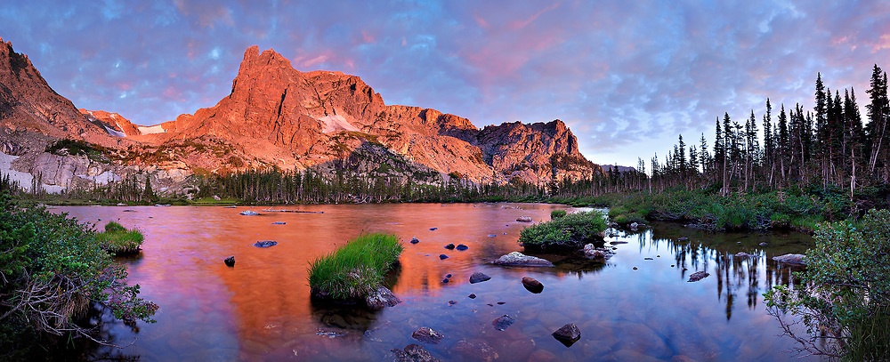 Notchtop Mountain at sunrise from Lake Helene, Rocky Mountain National Park.