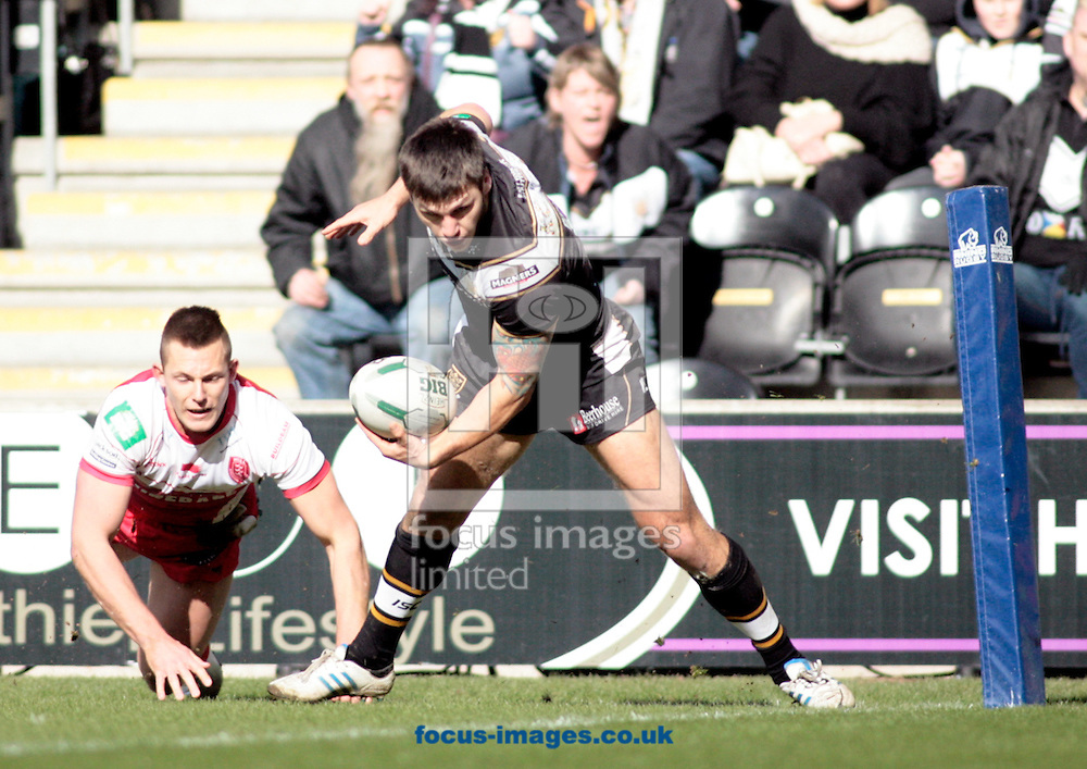 Picture by Richard Gould/Focus Images Ltd +447814 482222.29/03/2013.Tom Briscoe of Hull Football Club breaks away from Greg Eden of Hull Kingston Rovers during the Super League match at the KC Stadium, Kingston upon Hull.