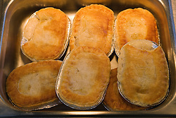 Tray of pies in school canteen,