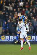 Shrewsbury Town's James Boltons and Wolverhampton Wanderers midfielder Morgan Gibbs-White (17) abcontest an aerial ball during the The FA Cup fourth round match between Shrewsbury Town and Wolverhampton Wanderers at Greenhous Meadow, Shrewsbury, England on 26 January 2019.