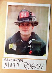 14 September 2001. New York, New York - USA.<br /> Post 9/11 World Trade Center attack.<br /> Matt Rogan, firefighter. Missing presumed dead. Hero firefighter, colleague of Mike Kehoe of Engine 28, Ladder 11 pictured in a memorial erected at their firehouse on East 2nd Street in the East village early in the morning of Sept 14th. <br /> Mike Kehoe's image had been published the day before on front pages around the world. It is the iconic image of him ascending the stairs of the World Trade Center as he helped to evacuate people from the terrorist attacks of 9/11. It was assumed Mike had perished when the buildings collapsed. However Mike had miraculously managed to escape the buildings moments before they collapsed. 6 members of his crew were not so fortunate. Mike became a symbol of heroism to many following the vicious Al Queda attacks which claimed over 2,000 victims at the WTC site. This images was published exclusively on the Front Page of the Daily Mirror on 15th Sept, 2001.<br /> Photo exclusive©; Charlie Varley/varleypix.com