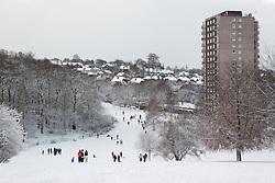 Snow scene in Woodthorpe Park, Nottingham, December 2010, with Woodthorpe Flats.