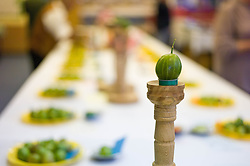 © Licensed to London News Pictures.04/08/15<br /> Egton, UK. <br /> <br /> <br /> Winning gooseberries are placed on mounts on a table for display during the annual Egton Gooseberry Show. <br /> There are only two Gooseberry societies left in the country. One in Cheshire and one at Egton in North Yorkshire. The annual show in Egton uses traditional Avoridupois scales to measure the weight of the berries and members of the society are fanatical about trying to grow the best berries each year. <br /> <br /> Photo credit : Ian Forsyth/LNP